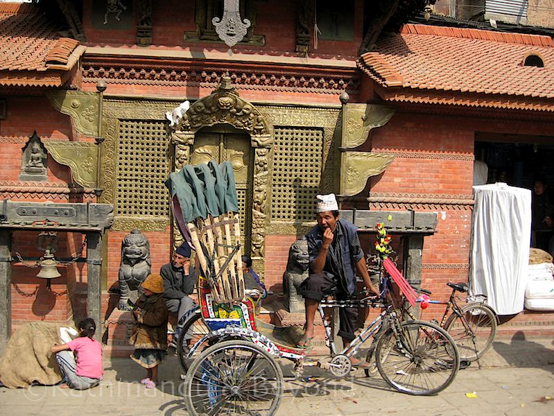 The rickshaw driver's having a lazy Sunday too - Durbar Square
