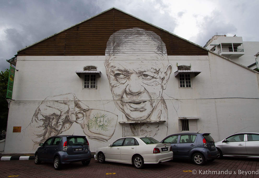 Old Uncle Drinking Coffee - Ernest Zacharevic Street Art in Ipoh, Malaysia