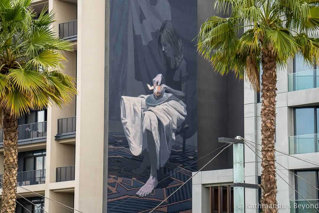 Girl with orange by Etam Cru, City Walk Street Art Dubai, United Arab Emirates