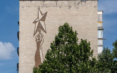 """Red Star"" on the side of an apartment building"