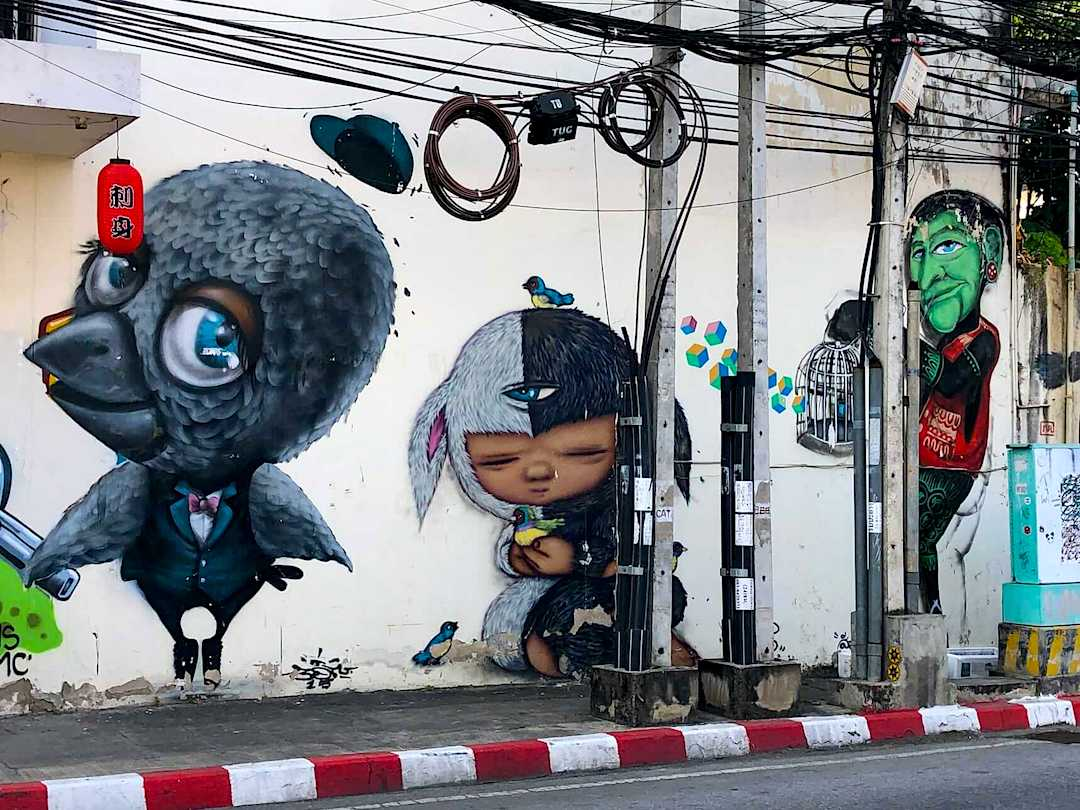 Mue Bon, Alex Face and Mr Ogay at the Freebird Cafe. Street Art Chiang Mai, Thailand
